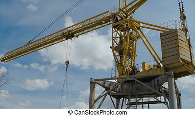 Yellow Hoisting Crane Moving with Cistern. Heave Industry