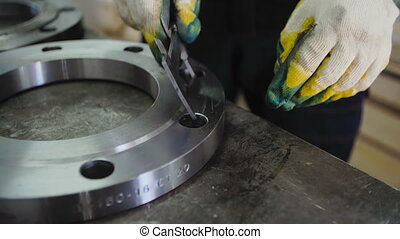 Worker Measures The Diameter with The Flange Caliper.Gas...