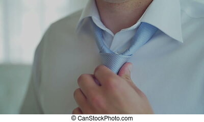 Businessman Pull his Tie. White Shirt