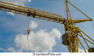 Yellow Hoisting Crane On Blue Sky. Heave Industry