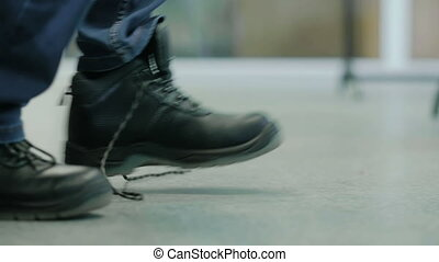Man Tying Shoelace on the Boots