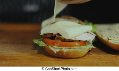 Chef Adds Cheese Slices On a Sandwich