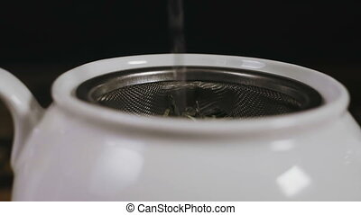 Adding Boiling water in The Kettle. Restaurant Business