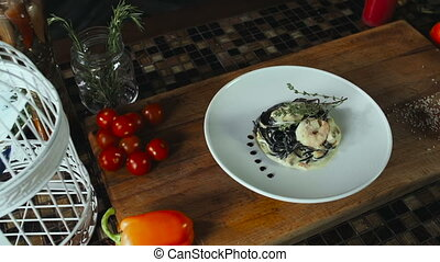 Black Spaghetti With Prawns And Seafood On White Plate -...