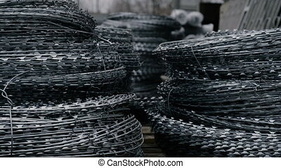 Stocks Of Barbed Wire in Store. Building materials store in...