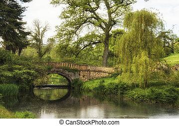 Stunning landscape image of old medieval bridge over river...
