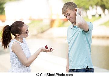 A woman making proposal to boyfriend - Pretty young woman...