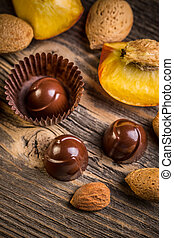 Chocolate bonbon with almond and apricot