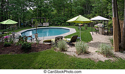 Luxurious In Ground Pool - A wide angle panoramic view of a...