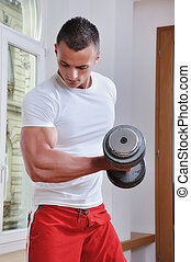 Powerful muscular man - Powerful muscular man lifting...