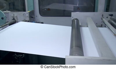 The machine for the preparation of the paper before cutting...