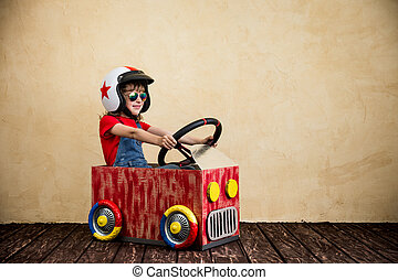 Travel and summer vacation concept - Child driving a car...