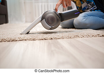Cleaning of rug in house portable rechargeable vacuum...