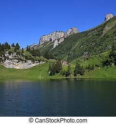 Lake Fahlensee and mountains of the Alpstein Range - Summer...