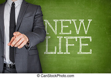 New life on blackboard with businessman - Concept on...