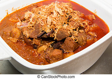 Beef  curry cooking in its spices