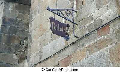 Stone wall with toilet sign in Saint-Malo, walled port city...
