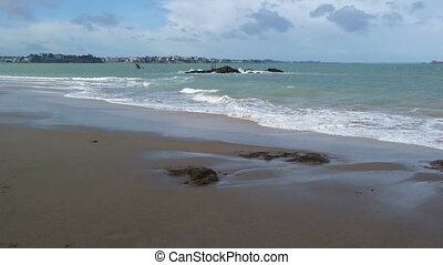 SAINT MALO, FRANCE - March 25, 2016: view of City wall and beach of Saint-Malo, walled port city in Brittany in northwestern France on English Channel