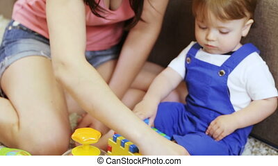 Children conundrum in child hands - Mom teaches young child...