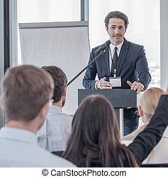 Speaker at presentation to audience - Speaker talking and...