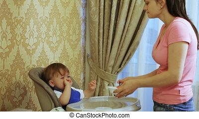Mum feeds child home