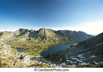 Polish Tatra Mountains - High peaks over the valley in Tatra...