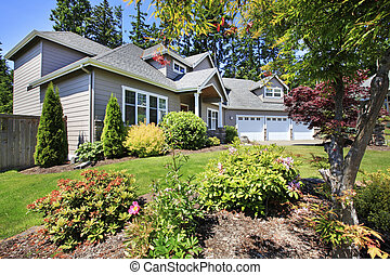Beautiful curb appeal of classic American home with nice landscape design.