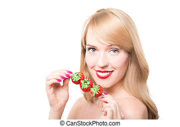 young woman with bare shoulders holding ripe strawberry -...