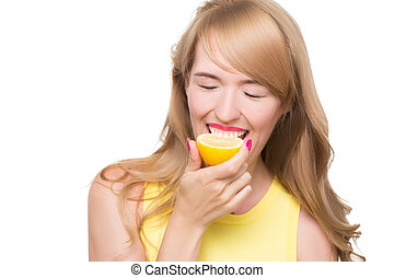 girl biting a lemon on a white background