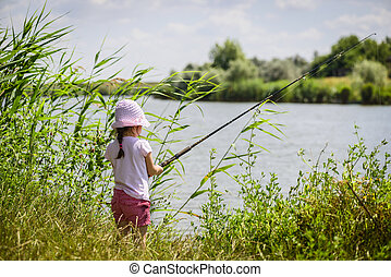 Little child fishing - Lonely little fisher girl sitting...