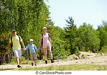 Family in the country - Portrait of happy family walking...