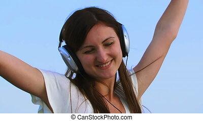 The girl in the big headphones