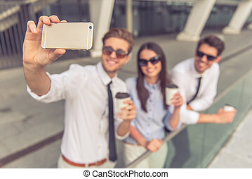 Business people with gadget - Handsome young business people...