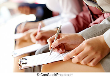 Business education - Businesspeople hands over papers making...
