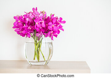 Orchid flower in vase decoration interior of room