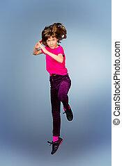 gladness - Happy smiling teen girl jumping for joy Full...