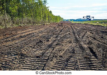 Road construction site - Forest being cut at a road...