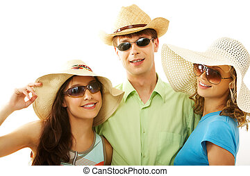Summer fashion - Portrait of happy man and girls in hats...