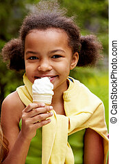 Cooling down - Portrait of pretty girl eating ice-cream