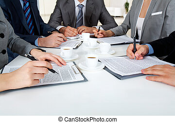 Written work - Image of business people hands with...