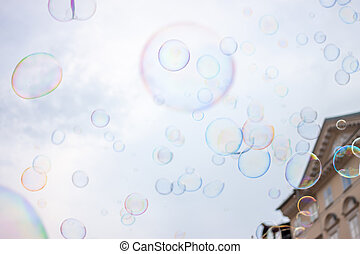Soap bubbles on sky background