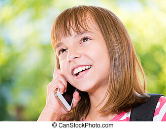 Girl with phone - Outdoor portrait of happy girl 10-11 year...
