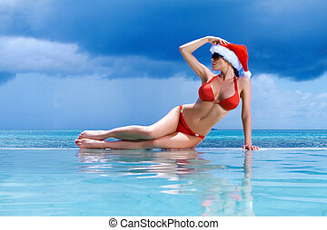 Woman at Maldives - Beautiful woman resting near pool at...