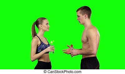 Couple doing a handshake in the gym Green screen - Young...