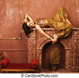 beauty sensual young woman in oriental style luxury room -...
