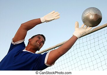 Soccer Goalkeeper - Soccer goalkeeper stretching to stop the...