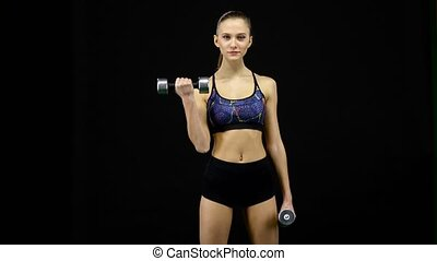 Girl is engaged in sports Lifting weights Black - Athlete...