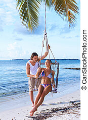 Couple next to Palm tree - Romantic couple having fun next...