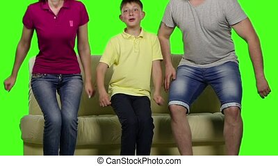 Family jumping on the couch Green screen Slow motion -...