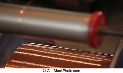 Bare bright copper wire on the spool Close up - Close up of...